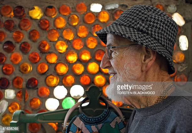 Arthur Germaine seeks the shelter of his 'Bottle House' in the outback opal mining town of Lightning Ridge on June 16 2008 Arthur spent 40 years...