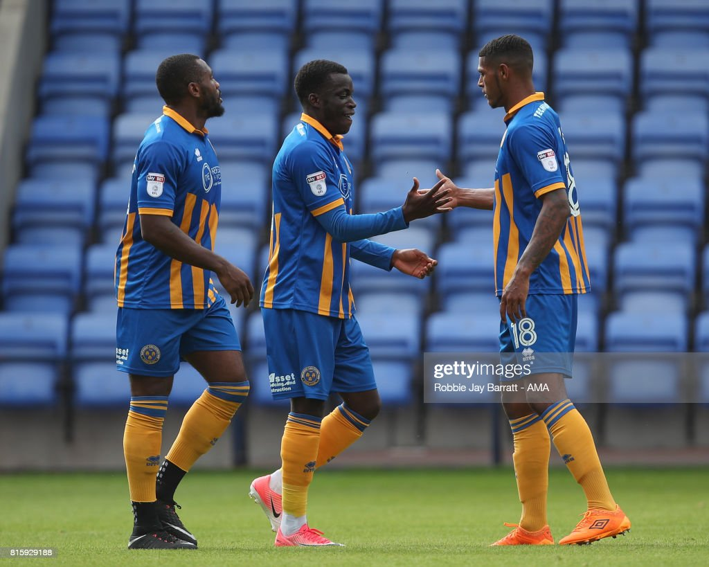 Arthur Gnahoua of Shrewsbury Town celebrates after scoring a goal to make it 1-0 during the pre-season friendly match between Shrewsbury Town and Aston Villa at Greenhous Meadow on July 15, 2017 in Shrewsbury, England.