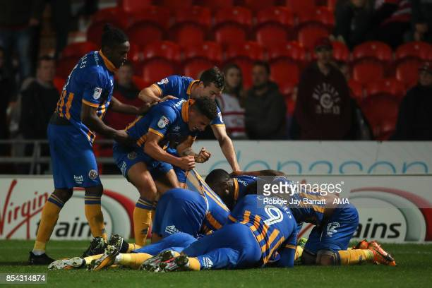 Arthur Gnahoua of Shrewsbury Town celebrates after scoring a goal to make it 12 during the Sky Bet League One match between Doncaster Rovers and...