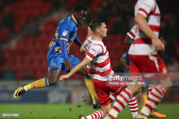 Arthur Gnahoua of Shrewsbury Town scores a goal to make it 12 during the Sky Bet League One match between Doncaster Rovers and Shrewsbury Town at...