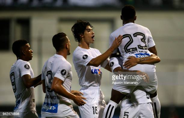 Arthur Gomes of Santos celebrates with his teammates after scoring the first goal of his team during a match between Estudiantes and Santos as part...