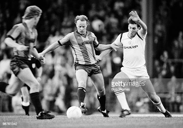 Arthur Graham of Bradford City holds off a challenge from Norman Whiteside of Manchester United during a Charity Game held at the Leeds Road Stadium...