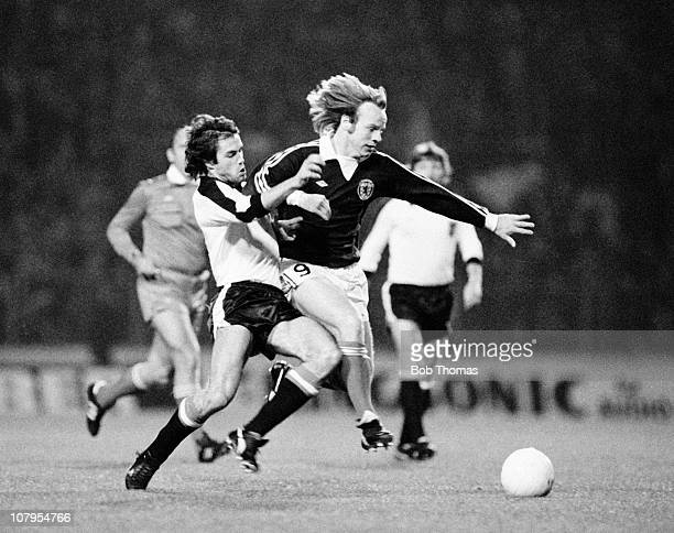 Arthur Graham of Scotland tackled by Herbert Weber of Austria during the Scotland v Austria European Championship Qualifying match played at Hampden...