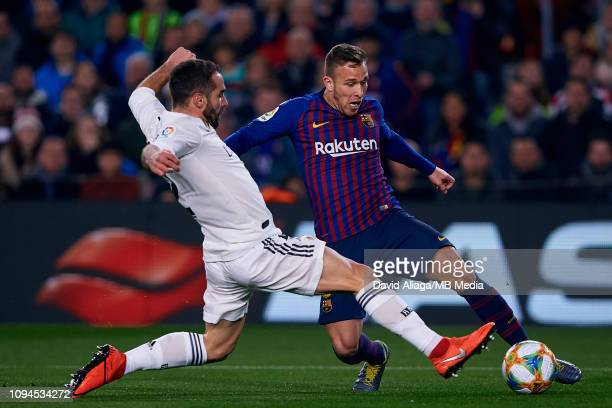 Arthur Henrique Ramos de Oliveira Melo of FC Barcelona competes for the ball with Dani Carvajal of Real Madrid CF during the Copa del Semi Final...