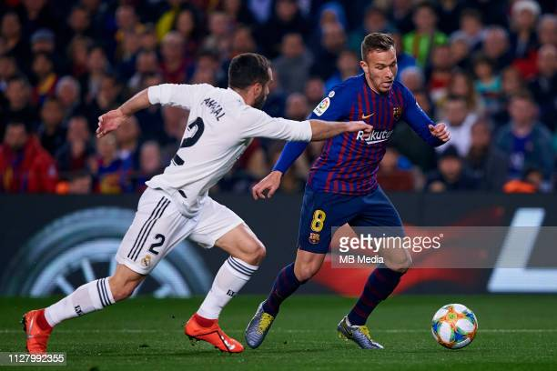 Arthur Henrique Ramos de Oliveira Melo of FC Barcelona competes for the ball with Dani Carvajal of Real Madrid CF during the Copa del Rey Semi Final...
