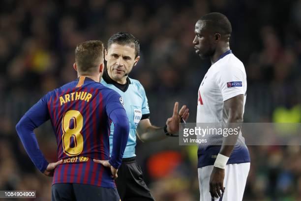Arthur Henrique Ramos de Oliveira Melo of FC Barcelona referee Milorad Mazic Moussa Sissoko of Tottenham Hotspur FC during the UEFA Champions League...