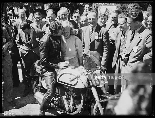 Arthur James Bell kisses his wife upon winning the Junior TT Race on the Isle of Man on a Norton motorcycle 7th June 1950