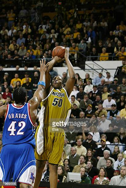 Arthur Johnson the University of MissouriColumbia Tigers takes a shot over Jeff Graves of the University of Kansas Jayhawks during the game at the...