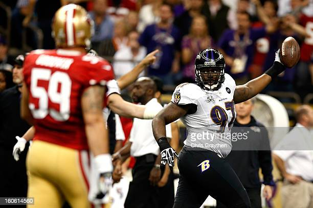 Arthur Jones of the Baltimore Ravens reacts after recovering a fumble from LaMichael James of the San Francisco 49ers in the second quarter during...