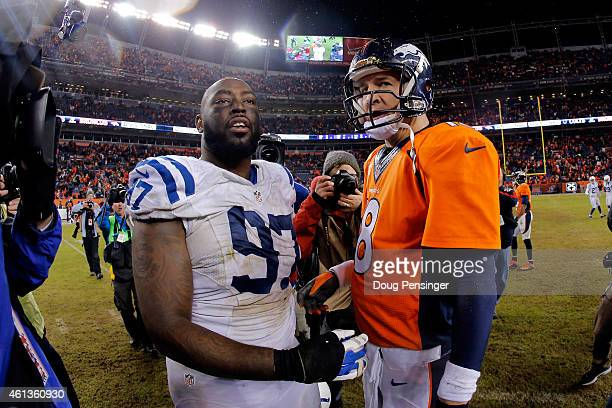 Arthur Jones of the Indianapolis Colts meets Peyton Manning of the Denver Broncos after a 2015 AFC Divisional Playoff game at Sports Authority Field...