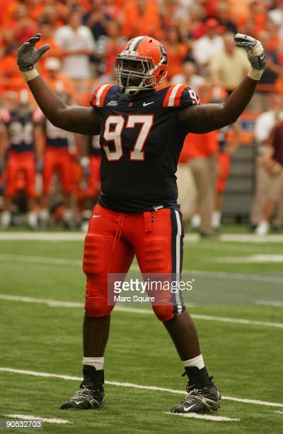 Arthur Jones of the Syracuse Orange pumps up the crowd during the game against the Minnesota Gophers at the Carrier Dome on September 5, 2009 in...