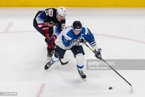 Arthur Kaliyev of the United States pursues Anton Lundell of Finland during the 2021 IIHF World Junior Championship semifinals at Rogers Place on...
