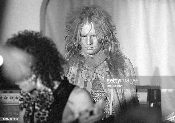 Arthur Kane of New York Dolls performs on stage at the Rainbow Room at the fashion store Biba in Kensington London on 26th November 1973