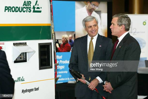 Arthur Katsaros Vice Group President of Air Products explains how a hydrogen fueling system works to US President George W Bush at an exhibition on...