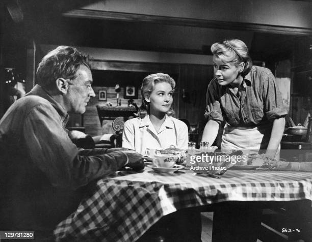 Arthur Kennedy Diane McBain and Constance Ford at the dinner table in a scene from the film 'Claudelle Inglish' 1961