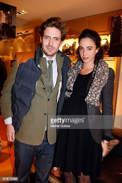 Arthur Kersauson and Luigi d'Urso daughter attend the Cocktail Party at Tods Shops to introduce new book Italian Touch on October 13 2009 in Paris...
