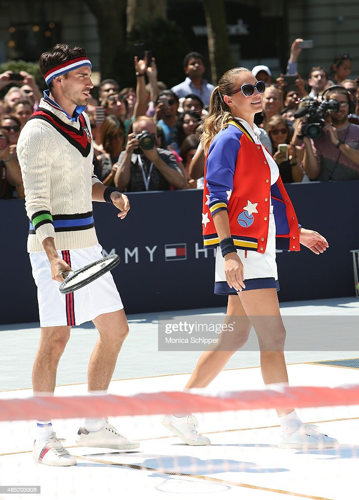 Arthur Kulkov (L) and Hannah Davis attend the Tommy Hilfiger And Rafael Nadal Global Brand Ambassadroship Launch Event at Bryant Park on August 25, 2015 in New York City.