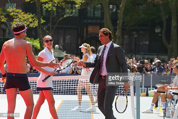 Arthur Kulkov Hannah Davis and Rafael Nadal play tennis at the Tommy Hilfiger and Rafael Nadal Global Brand Ambassadorship Launch at Bryant Park on...