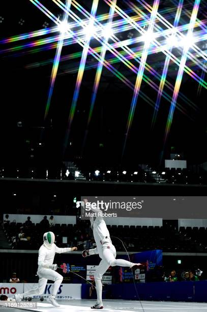 Arthur Lanigan O'Keeffe of Ireland competes against Kirill Kasyanik of Belarus during the mixed team relay fencing ranking round on day four of the...