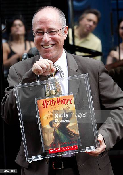 Arthur Levine editor of Harry Potter and the Deathly Hallows carried an autographed copy of the book during an event at Scholastic headquarters in...