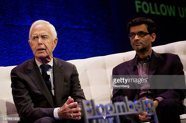 Arthur Levitt, senior advisor to the Carlyle Group LP and former chairman of the U.S. Securities and Exchange Commission , left, speaks while Manoj...