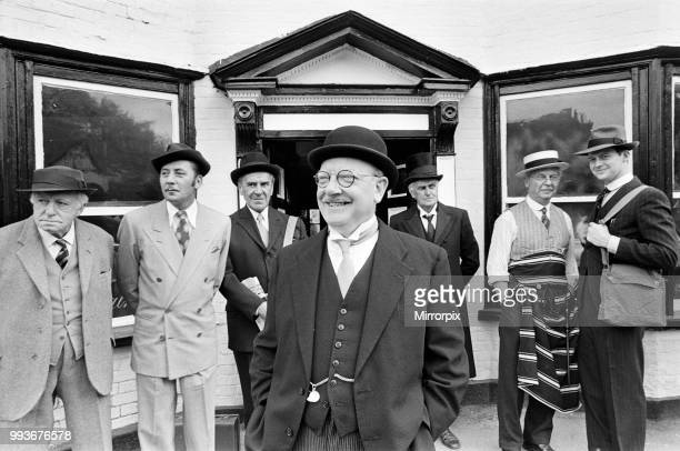Arthur Lowe as Captain Mainwaring during the filming of the Dad's Army film at Chalfont St Giles Buckinghamshire Also pictured are Arnold Ridley...