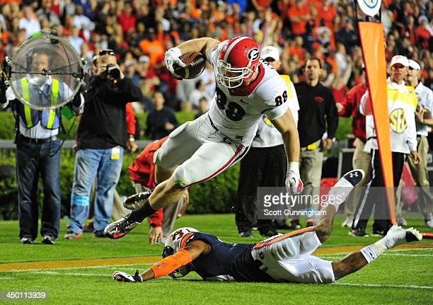 Arthur Lynch of the Georgia Bulldogs runs with a catch for a 4th quarter touchdown against Ryan White of the Auburn Tigers at JordanHare Stadium on...