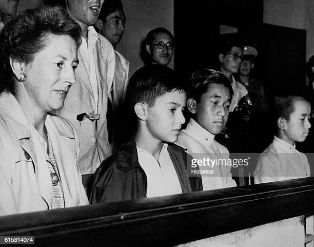 Arthur MacArthur the son of General Douglas MacArthur and Prince Akihito the son of Emperor Hirohito meet at a Tokyo swim meet