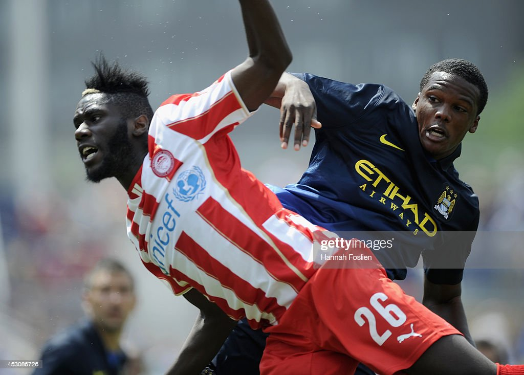 Arthur Masuaku #26 of Olympiacos and Yaya Toure #42 of Manchester City go after the ball during the first half of the International Champions Cup match on August 2, 2014 at TCF Bank Stadium in Minneapolis, Minnesota. The Olympiacos defeated the Manchester City in a penalty shootout.