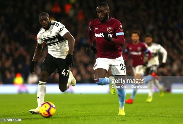 Arthur Masuaku of West Ham United and Aboubakar Kamara of Fulham FC in action during the Premier League match between Fulham FC and West Ham United...