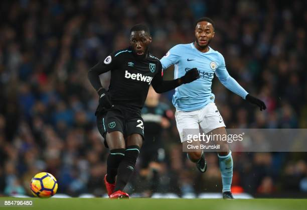 Arthur Masuaku of West Ham United and Raheem Sterling of Manchester City battle for possession during the Premier League match between Manchester...