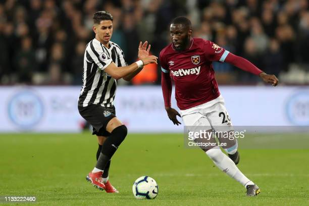 Arthur Masuaku of West Ham United battles for possession with Ayoze Perez of Newcastle United during the Premier League match between West Ham United...