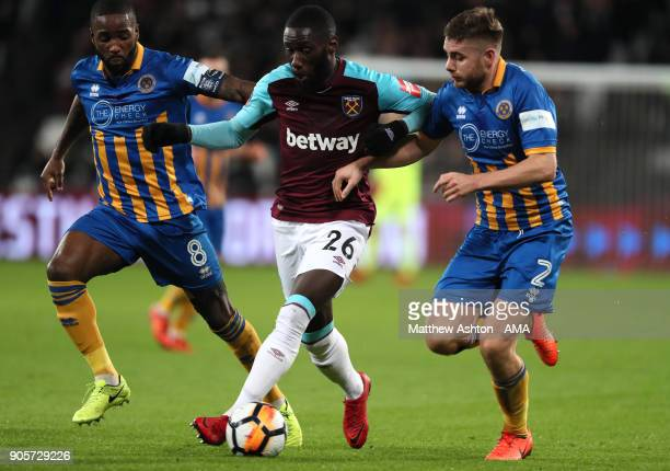 Arthur Masuaku of West Ham United competes with Abu Ogogo and Joe Riley of Shrewsbury Town during the Emirates FA Cup Third Round Repaly match...