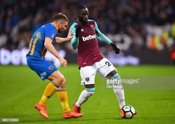 Arthur Masuaku of West Ham United holds off Joe Riley of Shrewsbury Town during The Emirates FA Cup Third Round Replay match between West Ham United...