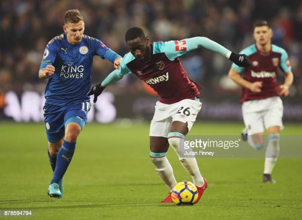 Arthur Masuaku of West Ham United holds off Marc Albrighton of Leicester City during the Premier League match between West Ham United and Leicester...