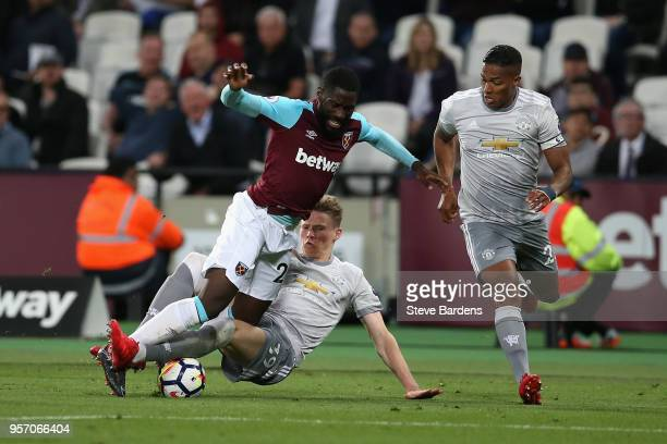 Arthur Masuaku of West Ham United is brought down by Scott McTominay of Manchester United during the Premier League match between West Ham United and...