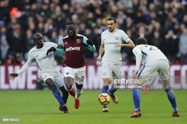 Arthur Masuaku of West Ham United is challenged by N'Golo Kante of Chelsea during the Premier League match between West Ham United and Chelsea at...