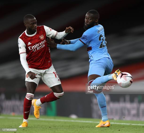 Arthur Masuaku of West Ham United is challenged by Nicolas Pepe of Arsenal during the Premier League match between Arsenal and West Ham United at...