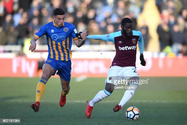 Arthur Masuaku of West Ham United is closed down by Ben Godfrey of Shrewsbury Town during The Emirates FA Cup Third Round match between Shrewsbury...