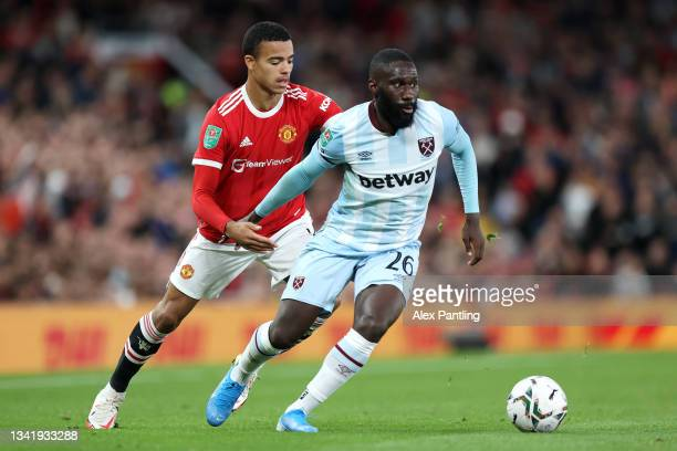 Arthur Masuaku of West Ham United is closed down by Mason Greenwood of Manchester United during the Carabao Cup Third Round match between Manchester...