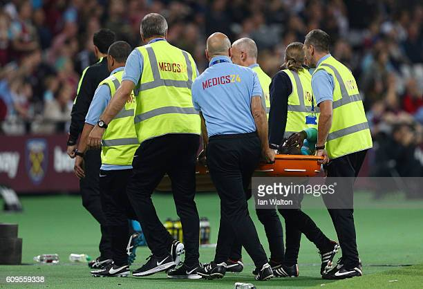 Arthur Masuaku of West Ham United leaves the pitch following an injury during the EFL Cup Third Round match between West Ham United and Accrington...