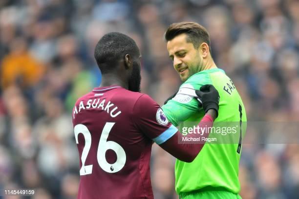 Arthur Masuaku of West Ham United puts a captain's armband on teammate Lukasz Fabianski during the Premier League match between Tottenham Hotspur and...