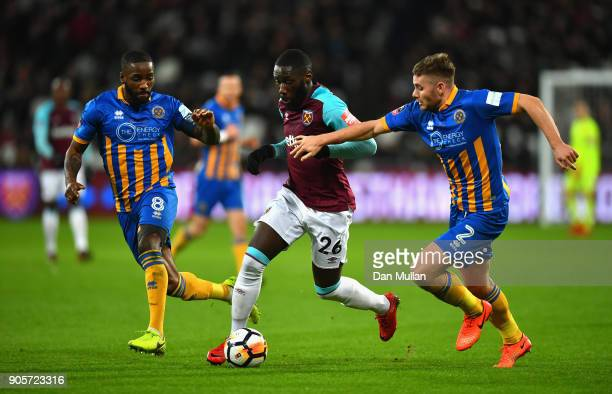 Arthur Masuaku of West Ham United takes on Joe Riley and Abumere Ogogo of Shrewsbury Town during The Emirates FA Cup Third Round Replay match between...