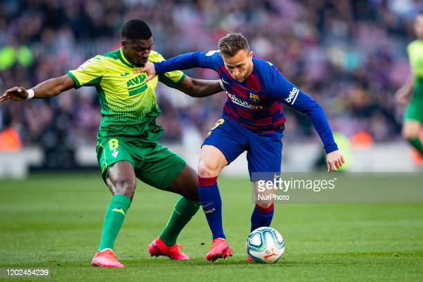 Arthur Melo from Brasil of FC Barcelona defended by P. Diop of SD Eibar during La Liga Santander match between FC Barcelona and SD Eibar at Camp Nou...