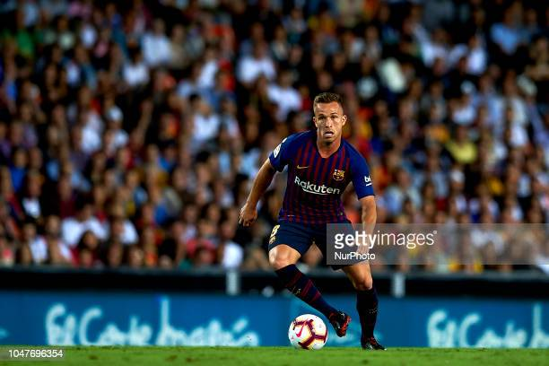 Arthur Melo in action during the week 8 of La Liga match between Valencia CF and FC Barcelona at Mestalla Stadium in Valencia Spain on October 7 2018