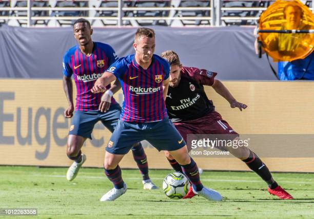 Arthur Melo Midfielder, FC Barcelona moves in front of Fabio Borini Midfielder, AC Milan for the ball during the International Champions Cup match...