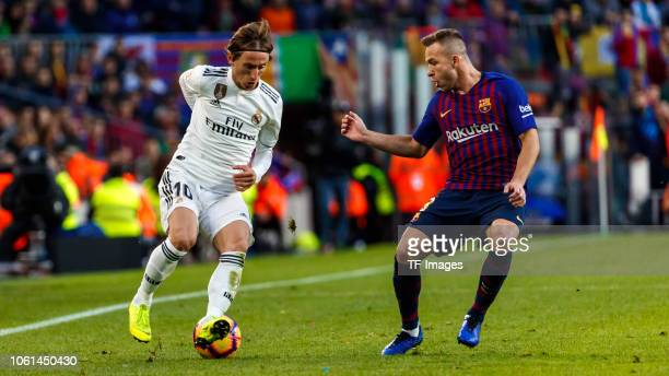 Arthur Melo of Barcelona and Luka Modric of Real Madrid battle for the ball during the La Liga match between FC Barcelona and Real Madrid CF at Camp...