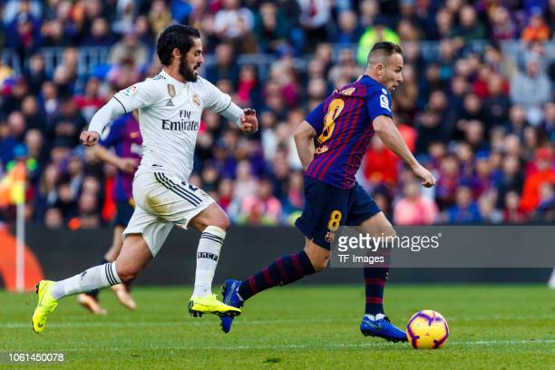 Arthur Melo of Barcelona Isco Alarcon of Real Madrid controls the ball during the La Liga match between FC Barcelona and Real Madrid CF at Camp Nou...