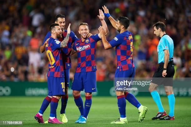 Arthur Melo of FC Barcelona celebrates with his teammates Sergio Busquets Luis Suarez and Lionel Messi after scoring his team's second goal during...