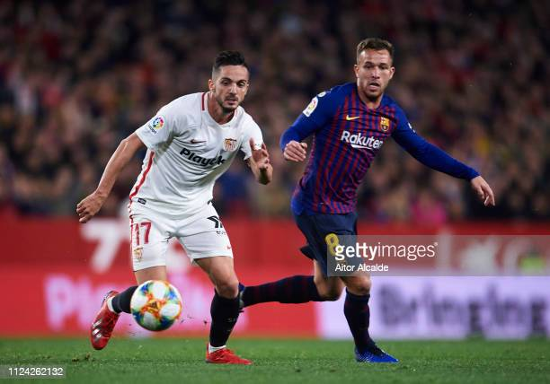 Arthur Melo of FC Barcelona competes for the ball with Pablo Sarabia of Sevilla FC during the Copa del Quarter Final match between Sevilla FC and FC...